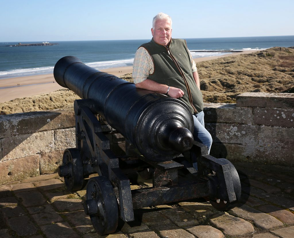 Francis Watson Armstrong owner of Bamburgh Castle rests against one of the 1400 year old cannons which overlook the Northumberland Coast. The castle is reopening its grounds to visitors on Monday 29th of March.